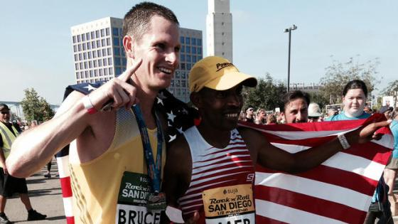 Marathon winner Ben Bruce (left) poses for a picture with Boston Marathon winner Meb Keflezighi (right).